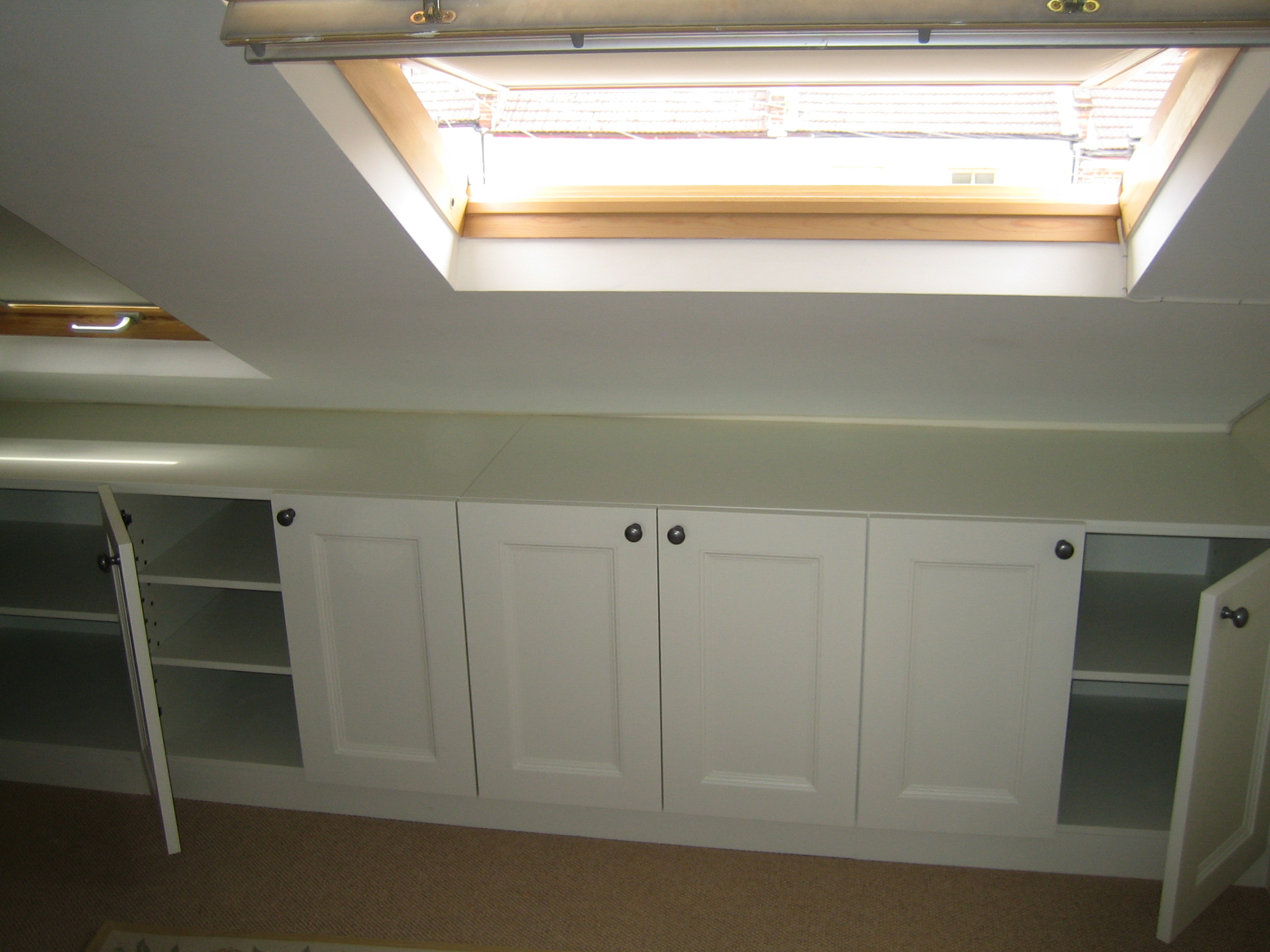 Loft Room Furniture traditional storage unit in loft room - london  carpentry solutions